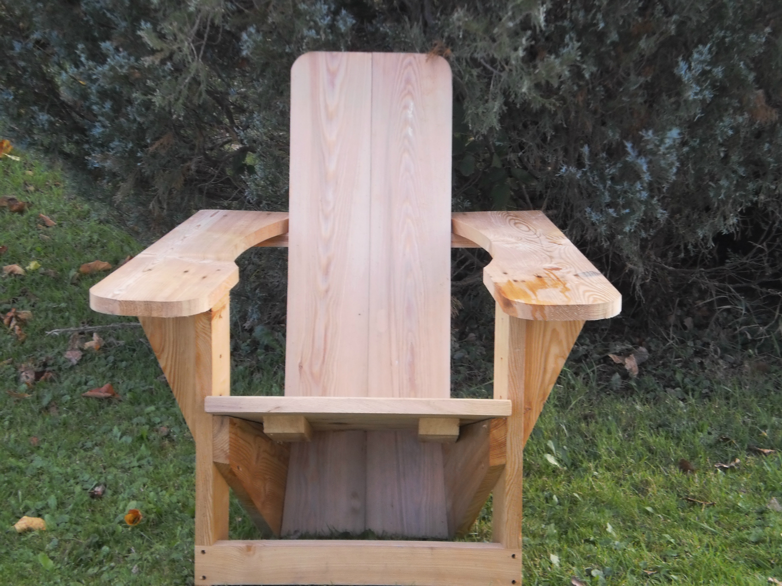 Front view of hand hewn timber lawn chair